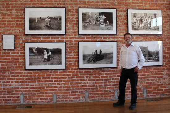 Greg Hoots in front of Kratzer photo exhibit