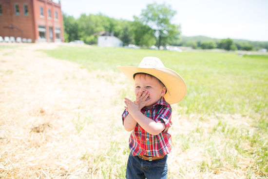 Little cowboy laughing at The Volland Store
